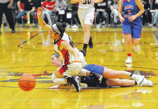 Shawnee's Eliyana Floyd gets tripped up by Wayne Trace's Brooke Sinn during Monday's game at Lappin Gymnasium.