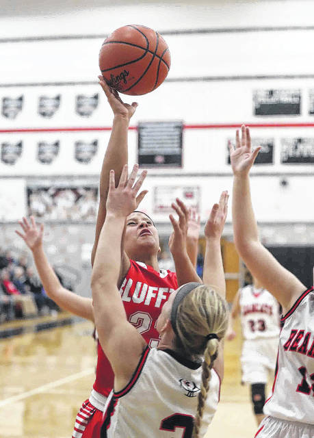 Bluffton's Alivia Koenig puts up a shot against Spencerville's Kaiden Grigsby during Thursday night's game Spencerville.