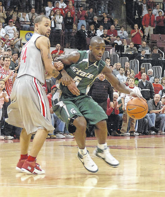 Michigan State's Travis Walton, a Lima Senior grad, is guarded by Ohio State's Jamar Butler, a Shawnee alum, during a 2008 game in Columbus.