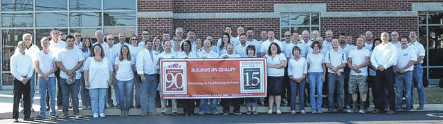 Tuttle Service Inc. employees celebrate the company's 90th anniversary.