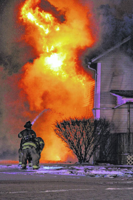 Firefighters battle a house fire very early Thursday at 4950 N. Wapak Road.