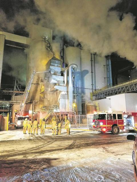 Delphos and American Township firefighters battle a fire at Bunge North America in Delphos Saturday night.