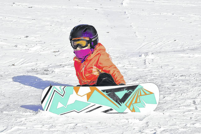 Willow Thomas, 4, tries to conquer the hill at Faurot Park, but ends up falling instead.