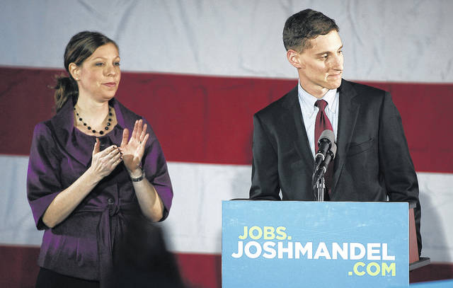 FILE – In this Nov. 6, 2012, file photo, Ohio state Treasurer and U.S. Senate candidate Josh Mandel, right, accompanied by his wife Ilana Shafran Mandel, left, concedes defeat to U.S. Sen. Sherrod Brown, D-Ohio, on election night in the ballroom at the Renaissance Hotel in Columbus, Ohio. Mandel was again seeking the Republican party nomination to challenge Brown in the 2018 general election, but announced Friday, Jan. 5, 2018, in an open letter that he decided to drop his bid, citing his wife's health.