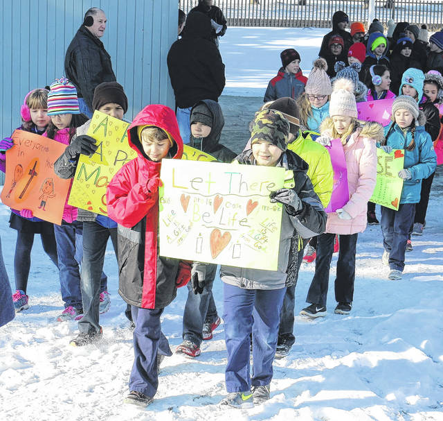 Students from St. Mary's Catholic School in Van Wert participated in a Mini-March for Life, going from Fountain Park to the Knights of Columbus Hall.