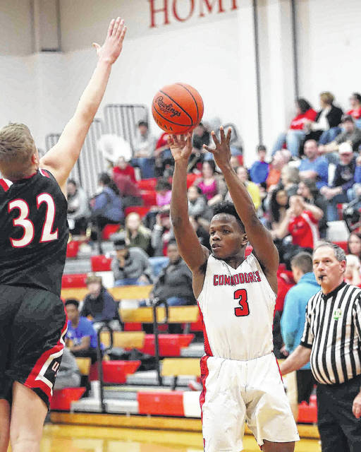 Perry's Nylan Cannon puts up a shot against Upper Scioto Valley's Quinn Sanders during Friday night's game at Perry.