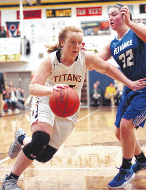 Ottawa-Glandorf's Kadie Hempfling drives to the basket against Defiance's Carlee Smiddy during the Titans' Western Buckeye League showdown this season. The Titans won the conference title.