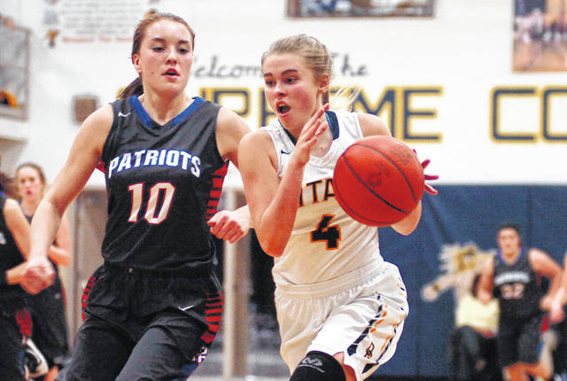 Ottawa-Glandorf's Kelsey Erford drives to the basket against Patrick Henry's Faith Frania during Tuesday night's game at Ottawa-Glandorf. See more game photos at LimaScores.com.