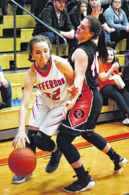 Delphos Jefferson's Delaney Duel drives to the basket Monday night against Fort Jennings' Lillian Wisner during the first half at Delphos Jefferson High School in Delphos.