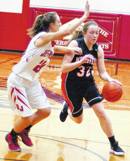 Fort Jennings' Kristen Luersman drives to the basket Monday night against Delphos Jefferson's Alli McClurg during the first half at Delphos Jefferson High School in Delphos.
