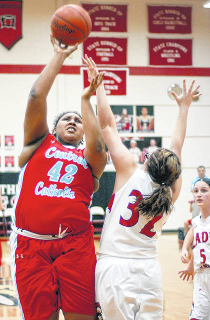 Lima Central Catholic's Tae Rios goes up for a shot against Perry's Madison Amstutz during Tuesday night's Division III tournament game at Bluffton High School.