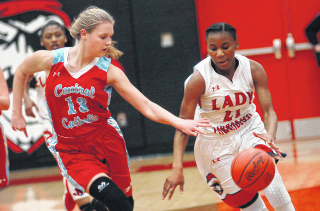 Perry's Tia Barfield drives against Lima Central Catholic's Jessica Wilker during Tuesday night's Division III tournament game at Bluffton High School. See more tourney photos at LimaScores.com.