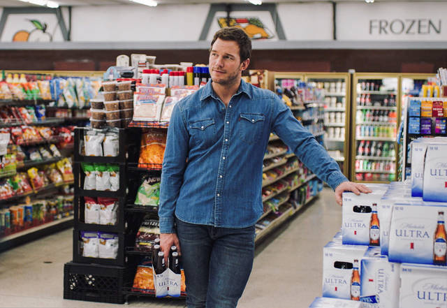 """This image released by Anheuser-Busch shows actor Chris Pratt in a scene from a Michelob Ultra commercial. Pratt, the star of the """"Jurassic World"""" and """"Guardians of the Galaxy"""" film franchises, will make his advertising debut on Super Bowl Sunday, Feb. 4, 2018, in a pair of commercials for the light beer. (Anheuser-Busch via AP)"""