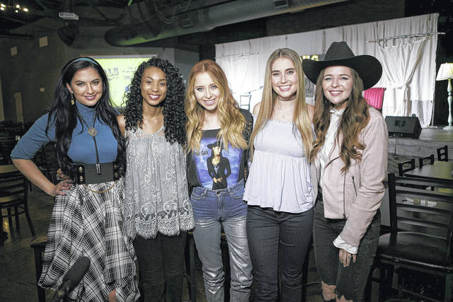 """Members of the Song Suffragettes, from left, Candi Carpenter, Tiera Leftwich, Kalie Shorr, Chloe Gilligan and Jenna Paulette pose for a photo in Nashville, Tenn. Female musicians in Nashville have long complained about the lack of representation on country radio, but now a collective of female songwriters are singing """"Time's Up."""""""