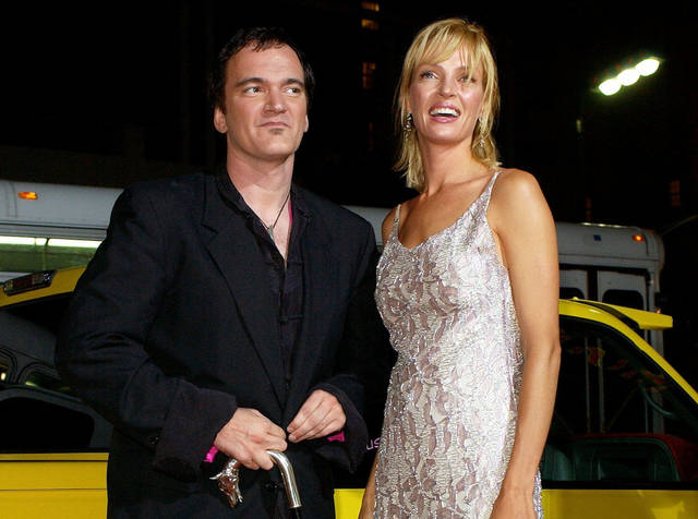"Quentin Tarantino, left, the director of the film ""Kill Bill: Volume 1,"" and actress Uma Thurman arrive at the premiere of the film in Los Angeles in 2003. Tarantino expressed sorrow for the car crash that injured Uma Thurman during shooting of ""Kill Bill,"" calling it the biggest regret of his life."