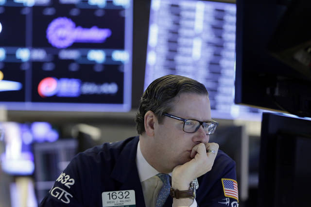Specialist Gregg Maloney works at his post on the floor of the New York Stock Exchange, Wednesday, Feb. 7, 2018. Stocks are opening modestly higher on Wall Street as the market stabilizes following three days of tumult. (AP Photo/Richard Drew)