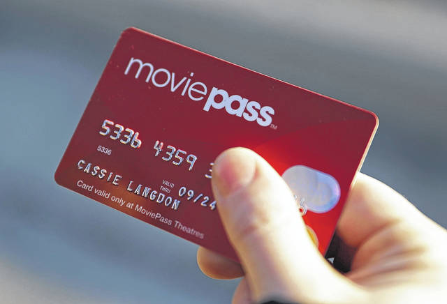 Cassie Langdon holds her MoviePass card outside AMC Indianapolis 17 theatre in Indianapolis last month. With MoviePass, Langdon said she's taking more chances on smaller releases instead of sticking with blockbusters and their sequels.