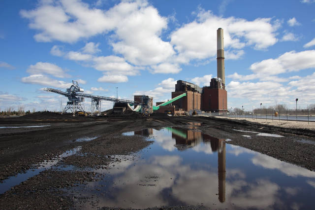 FILE - In this April 12, 2016, file photo, the B.C. Cobb Plant, which closed April 15, 2016 is shown in Muskegon, Mich. A major Michigan utility says it will reduce carbon emissions by 80 percent and no longer use coal to generate electricity by 2040. Consumers Energy is the second state utility to announce it's phasing out coal as it switches more to cleaner and renewable sources. (Joel Bissell//Muskegon Chronicle via AP, File)