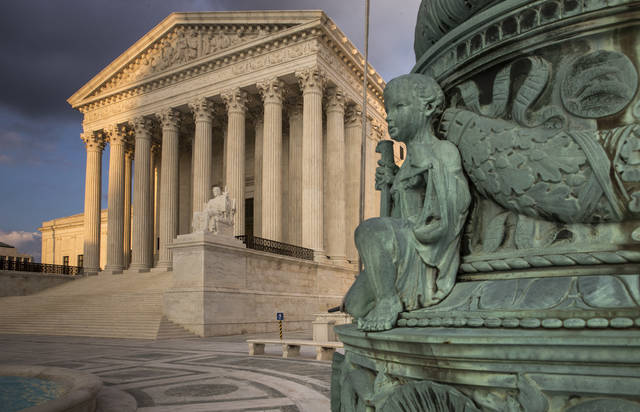 FILE - In this Oct. 10, 2017, file photo, the Supreme Court in Washington, at sunset. America's labor unions are about to find out if they were right about Justice Neil Gorsuch. In opposing Gorsuch's nomination to the high court last year, labor leaders said Gorsuch would vote against working people and for monied interests. The newest justice holds the deciding vote in a case to be argued Feb. 26 that is likely to affect the financial viability of unions that represent government workers. (AP Photo/J. Scott Applewhite, File)
