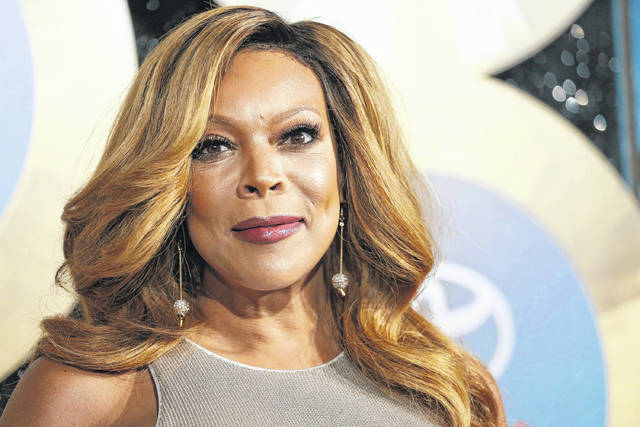 In this 2014 photo, TV talk show host Wendy Williams arrives during the Soul Train Awards in Las Vegas. Williams is taking three weeks off on doctor's orders. She said told her audience Wednesday that her doctor told her to take the break to deal with her Grave's Disease and hyperthyroidism.
