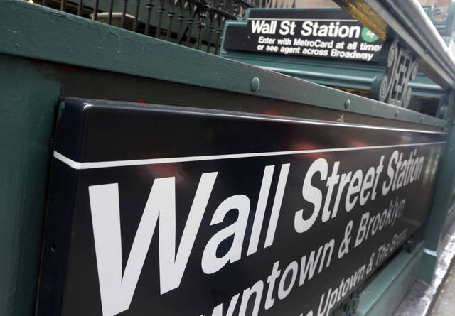 FILE- In this Oct. 2, 2014, file photo, the Wall Street subway stop on Broadway, in New York's Financial District. The U.S. stock market opens at 9:30 a.m. EST on Wednesday, Feb. 21, 2018. (AP Photo/Richard Drew, File)