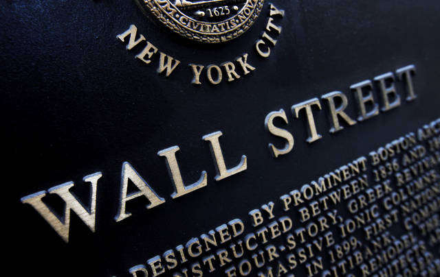 FILE - This Jan. 4, 2010, file photo shows an historic marker on Wall Street in New York. The U.S. stock market opens at 9:30 a.m. EST on Tuesday, Feb. 27, 2018. (AP Photo/Mark Lennihan, File)