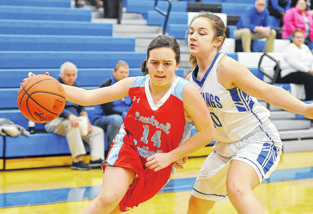 Lima Central Catholic's Erin Mulcahy drives against Allen East's Lakin Basham during Tuesday night's game at Allen East High School.