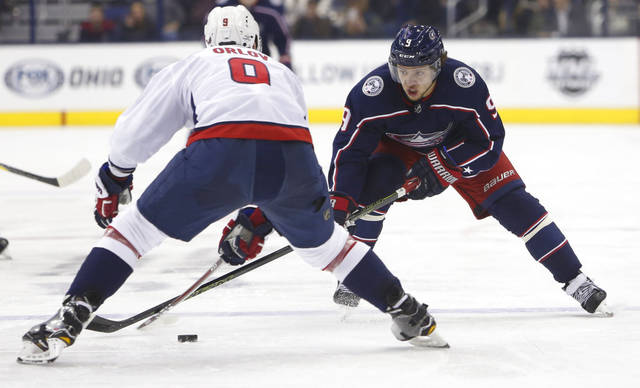 Columbus Blue Jackets' Artemi Panarin, right, of Russia, carries the puck across the blue line as Washington Capitals' Dmitry Orlov, of Russia, defends during the second period of an NHL hockey game Tuesday, Feb. 6, 2018, in Columbus, Ohio. (AP Photo/Jay LaPrete)