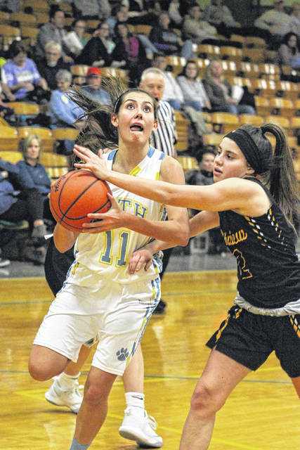 Bath Wildcat Senior Jaidyn Hale goes low for a lay-up against Northview's Anika Sweeney on Monday evening at Bath.