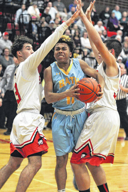 Bath's Steven Shook gets squeezed by Shawnee's Riley Rosado, left, and Tyson Elwer during Friday night's game at Shawnee.