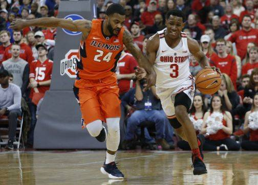 Ohio State's C.J. Jackson, right, brings the ball upcourt against Illinois' Mark Alstork during the second half of an NCAA college basketball game Sunday, Feb. 4, 2018, in Columbus, Ohio. (AP Photo/Jay LaPrete)