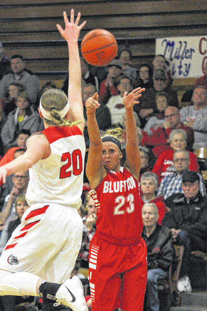 Bluffton's Alivia Koenig puts up a shot against Columbus Groves's Carlee McCluer during a Saturday night Division IV sectional final at Bath.