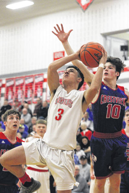 Columbus Grove's Caleb Barrientes drives while being pursued by Crestview's Drew Kline of Crestview during Friday night's game at Columbus Grove.