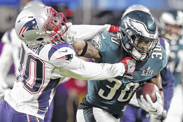 2ef8054de52 Philadelphia Eagles running back Corey Clement (30), right, runs against  New England Patriots strong safety Duron Harmon (30), during the first half  of the ...
