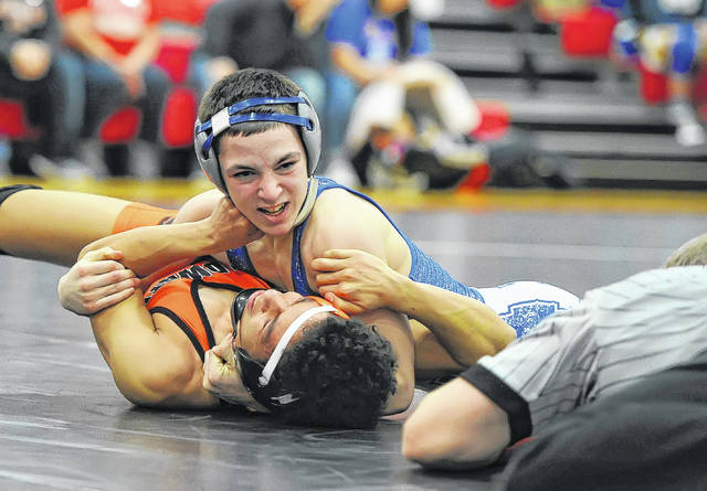 Allen East's Chase Caprella looks to pin Coldwater's Brian Chmielewski during Saturday's Division III Sectional Tournament at Msgr. Edward C. Herr Gymnasium. See more photos at LimaScores.com.