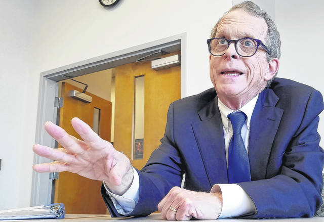 David Trinko | The Lima News Ohio Attorney General Mike DeWine warned residents about common scams this time of year during a visit to The Lima News on Tuesday.