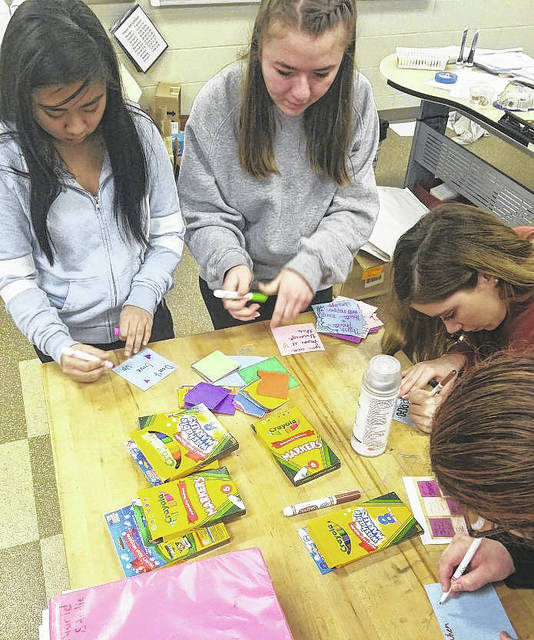 Elida High School students create sentimental messages for Stoneman Douglas High School students who survived the mass shooting that occurred on Feb. 14, 2018.