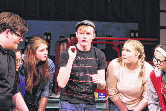 """The cast of """"The Rehearsal"""" gathers around Jon Allen, middle, during rehearsal at Encore Theatre."""