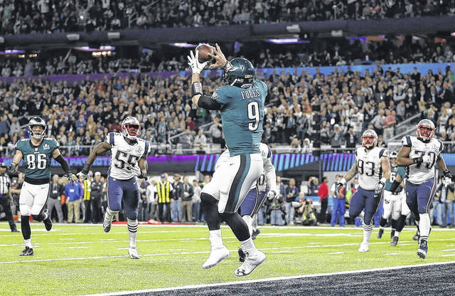 Philadelphia Eagles quarterback Nick Foles catches a touchdown pass on a fourth down trick play late in the first half of during the first half of Super Bowl 52.