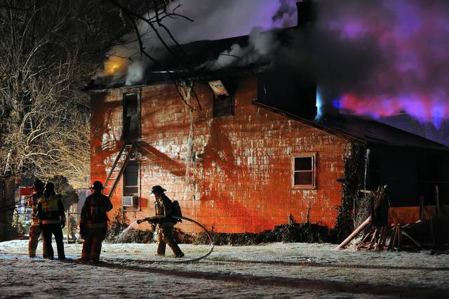 Lima firefighters battled a two-story house fire at 544 E. Second St. on Wednesday night.