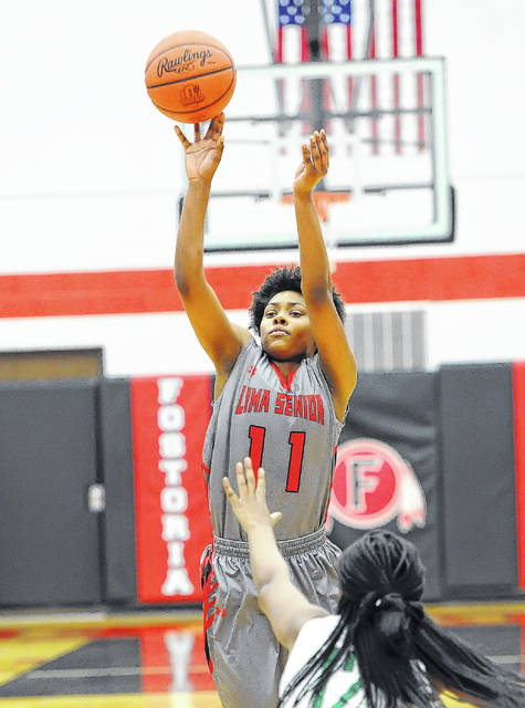 Lima Senior's Taja Oglesbee puts up a shot during a Thursday night Division I sectional final at Fostoria High School.