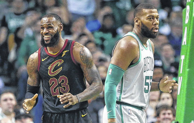 LeBron James (23) reacts to a call that obviously went the way of the Cleveland Cavaliers beside the Boston Celtics' Greg Monroe (55) during a game Sunday in Boston.