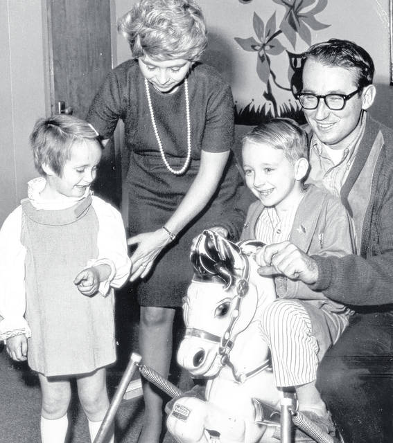 Matthew Winkler, 6, and his sister Valerie, 5, are shown with their parents, Mr. and Mrs. Nicholas Winkler, in St. Rita's Hospital in December 1970. When Matthew became the first survivor of rabies, newspapers across the country sent reporters to Lima, including the New York Times.