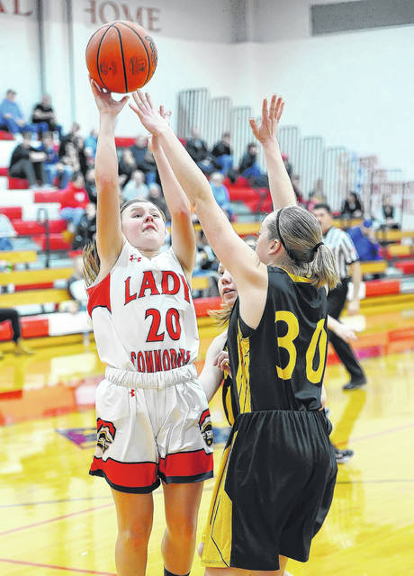 Perry's Lily Ford shoots against Botkins Sydney Meyer during Mondays' game at Leonard V. Volbert Gymnasium. Floyd finished with nine points.