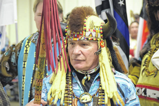 Don Horn leads the Grand Entry at the Lima Powwow Saturday afternoon at the Allen County Fairgrounds.