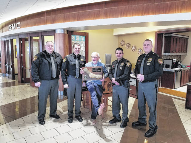 Photo submitted Tom Ahl, center, was the recipient of Allen County Sheriff Matt Treglia's Sheriff's Civilian Commendation for 2018. Pictured from the left are Brian Winegardner, chief deputy; Tregia; Ahl; Andre McConnahea, public information officer; and Major Todd Mohler.