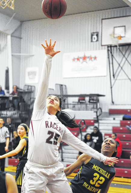 UNOH's Emily Patton shoots against Sade Lemons of UM-Dearborn during the first half at The Garage Gymnasium. Patton finished with 21 points.