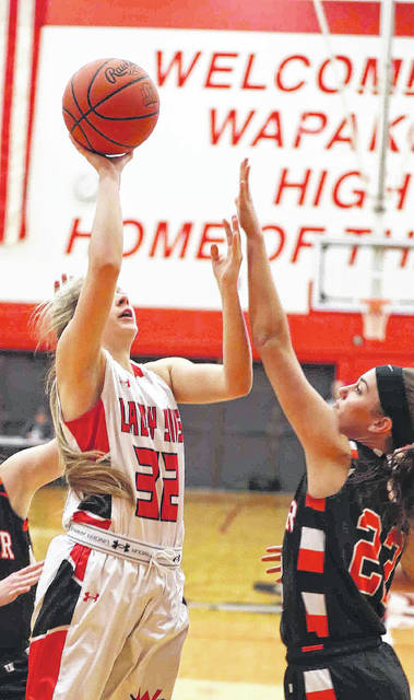 Wapakoneta's Jessica Davis puts up a shot against Minster's Kendra Thien during Tuesday night's game at Wapakoneta High School. See more game photos at LimaScores.com.