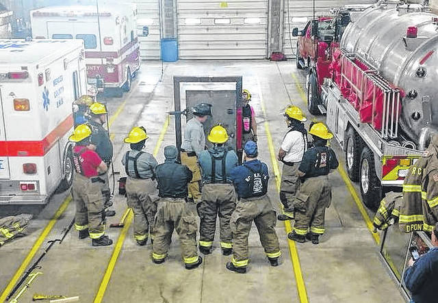 Firefighters learn from instructors with Western Buckeye Fire Training LLC, a company owned and operated by 26-year-oldAmerican Township Firefighter paramedic Jordan Hempker.