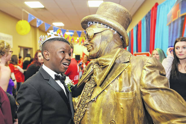 Mutte Mayes (left) and performer Mark Abbati during the Night to Shine prom sponsored by the Tim Tebow Foundation held at the First Assembly of God on Friday evening.